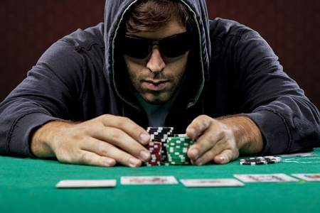 Poker player, on a red background, going all in.