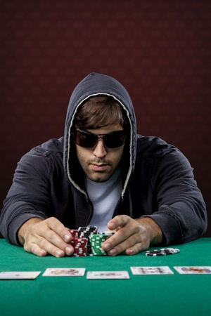 poker chips: Poker player, on a red background, going all in.