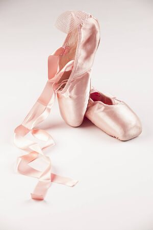pointe shoe: Pink Ballet shoes on white background.