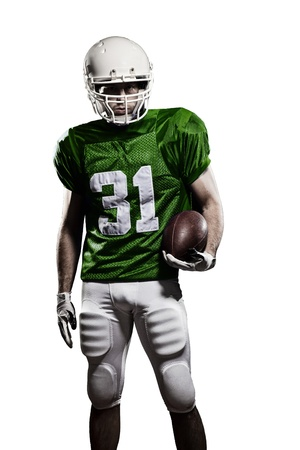 sports uniform: Football Player with a green uniform and a ball in the hand on a white background.