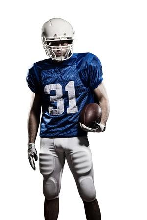 jugador de futbol: Jugador de f�tbol con un uniforme azul y una pelota en la mano sobre un fondo blanco. Foto de archivo