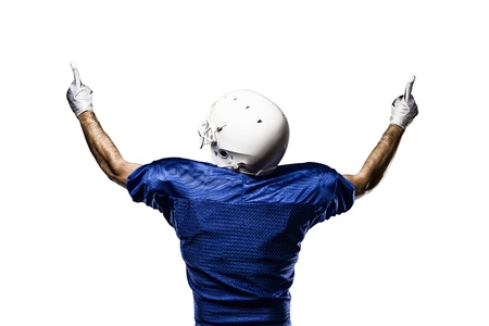 Football Player with a blue uniform celebrating on a White background. Standard-Bild
