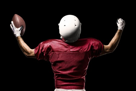 american football player: Football Player with a Red uniform celebrating on a Black background. Stock Photo