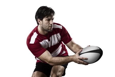 pelota rugby: El jugador de rugby en un uniforme rojo
