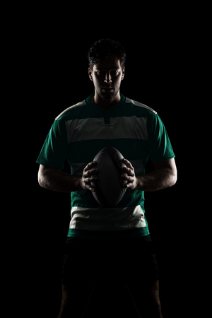 Rugby player in a green uniform