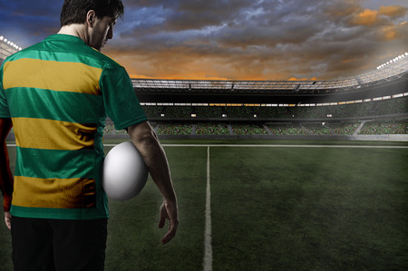 Rugby player in a green and gold uniform