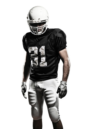 Football Player with a black uniform, on a white background Stock Photo