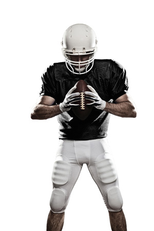 american football player: Football Player with a black uniform, on a white background Stock Photo