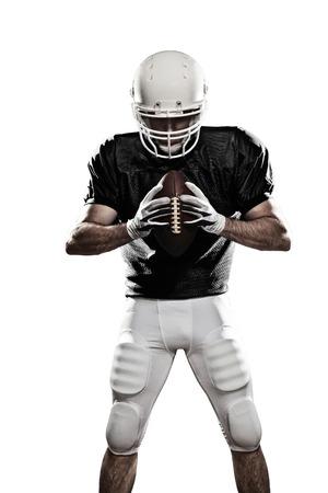 the football player: Jugador de f�tbol con un uniforme negro, sobre un fondo blanco Foto de archivo