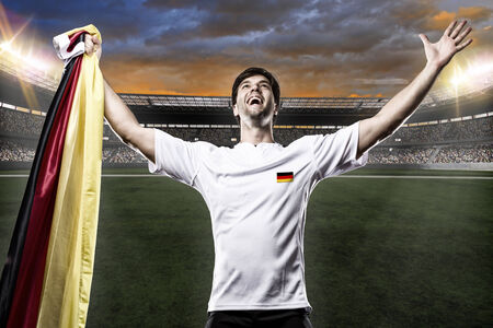 Germany soccer player, celebrating with the fans. photo
