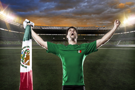 Mexican soccer player, celebrating with the fans.