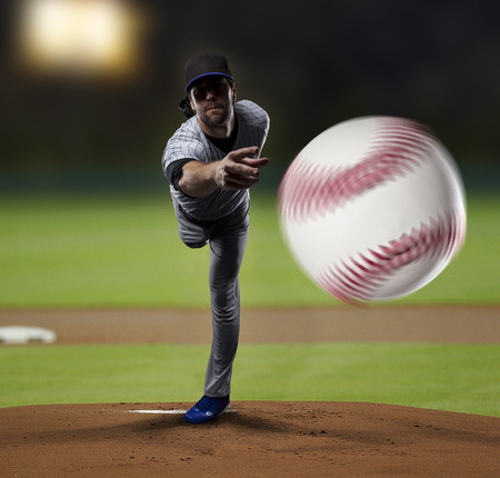 Pitcher Baseball Player on a Blue Uniform on baseball\ Stadium.