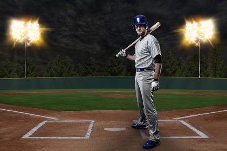Baseball Player on a Blue Uniform on baseball Stadium. photo