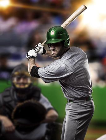 baseball stadium: Baseball Player on a Green Uniform on baseball Stadium. Stock Photo