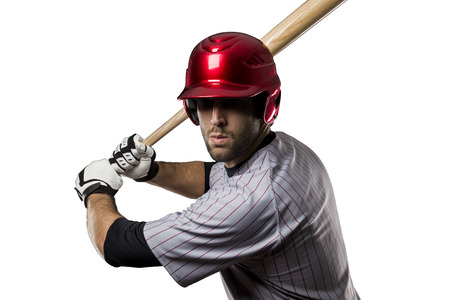 Baseball Player in red uniform, on a white background. Stock Photo