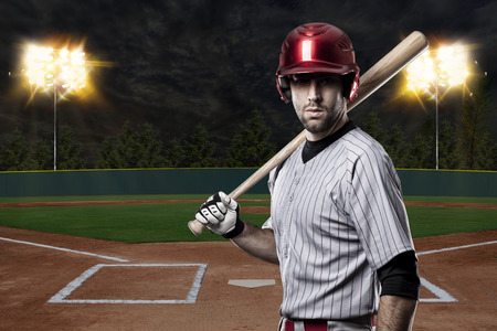 baseball cap: Baseball Player on a baseball Stadium. Stock Photo