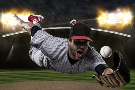 baseball stadium: Baseball Player on a baseball Stadium. Stock Photo