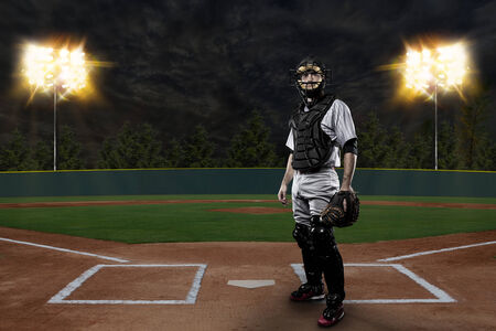 baseball cap: Catcher Baseball Player on a baseball Stadium.