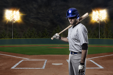 baseball stadium: Baseball Player on a Blue Uniform on baseball Stadium.