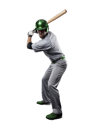 baseball bat: Baseball Player in a Green uniform, on a white background.