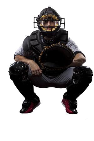 Catcher jugador de béisbol, sobre un fondo blanco. Foto de archivo - 27529058