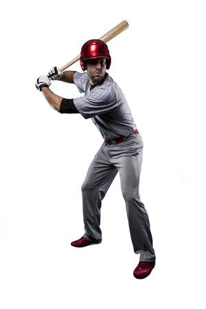 Baseball Player in red uniform, on a white background. Standard-Bild