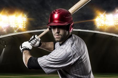 baseball bat: Baseball Player on a baseball Stadium. Stock Photo
