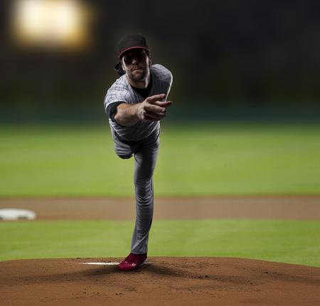 Pitcher  Player throwing a ball, on a baseball Stadium. photo