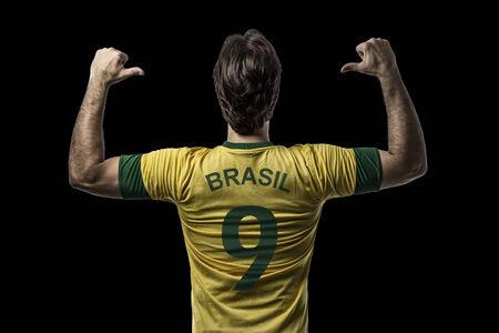 Brazilian soccer player, celebrating on a Black background.