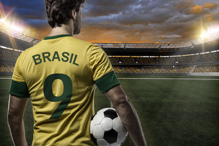 Brazilian soccer player, celebrating with the fans, on a Stadium. Stock Photo