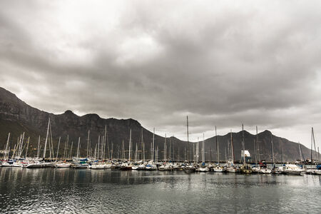 gig harbor: boats on a cloudy harbor in south africa Stock Photo