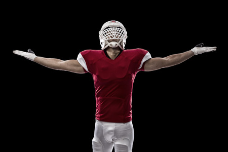 football tackle: Football Player with a red uniform celebrating, on a Black background.