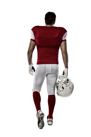 football tackle: Football Player with a red uniform walking, showing his back on a white background.