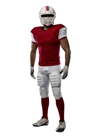 futbolista: Jugador de fútbol con un uniforme rojo sobre un fondo blanco.