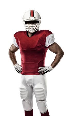 football players: Jugador de f�tbol con un uniforme rojo sobre un fondo blanco.