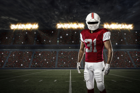 player: Football Player with a red uniform on a stadium.