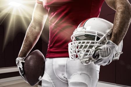 Fußball-Spieler mit einem roten Uniform auf einem Locker Roon. Standard-Bild - 35218418