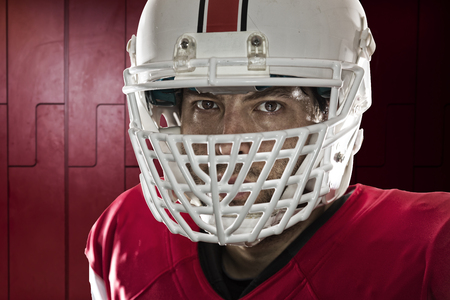 Close up in the eyes of a Football Player with a red uniform on a locker roon. photo