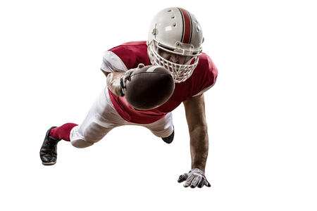 football tackle: Football Player with a red uniform scoring on a white background. Stock Photo