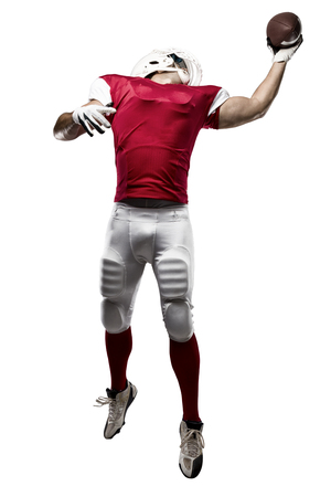 football tackle: Football Player with a red uniform making a catching on a white background. Stock Photo