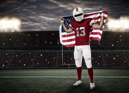 Football Player with a red uniform and a american flag, on a stadium. photo