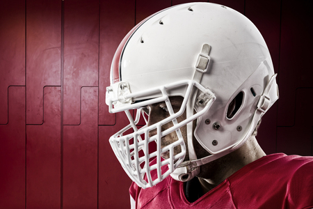 Close up of a Football Player with a red uniform on a locker roon. photo