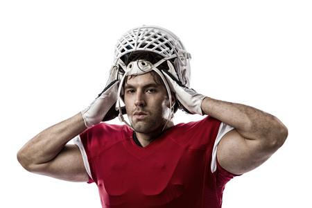 jugando futbol: Jugador de f�tbol con un uniforme rojo sobre un fondo blanco.
