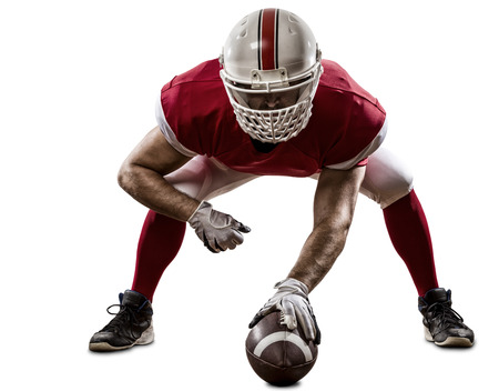 Football Player with a red uniform on the scrimmage line, on a white background.