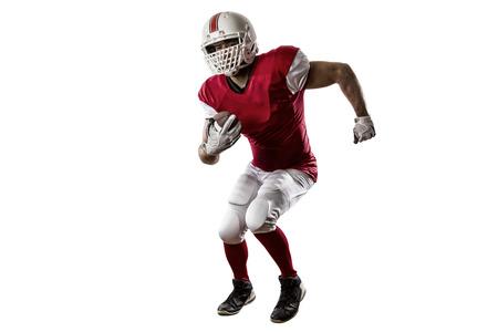 jugador de futbol: Jugador de f�tbol con un uniforme rojo que se ejecuta en un fondo blanco. Foto de archivo
