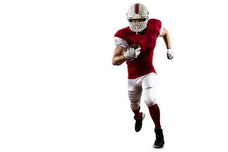 futbolista: Jugador de fútbol con un uniforme rojo que se ejecuta en un fondo blanco. Foto de archivo