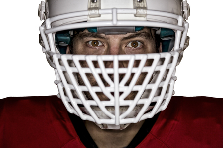 football tackle: Close up in the eyes of a Football Player with a red uniform on a white background. Stock Photo