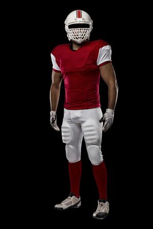 Football Player with a red uniform on a black background.