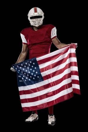 jugador de futbol: Jugador de f�tbol con un uniforme rojo y una bandera americana, en un fondo Negro. Foto de archivo