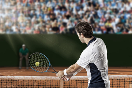 returning: Tennis player returning a ball on a clay tennis court.